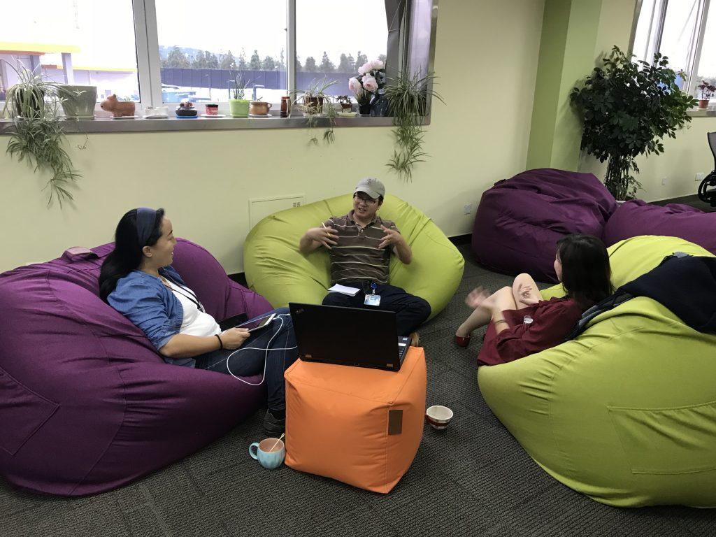 Imagineers having an informal meeting on bean bag chairs.