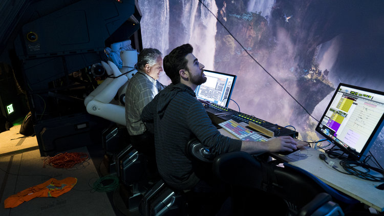 Imagineers editing video and audio in the visual effects studio.