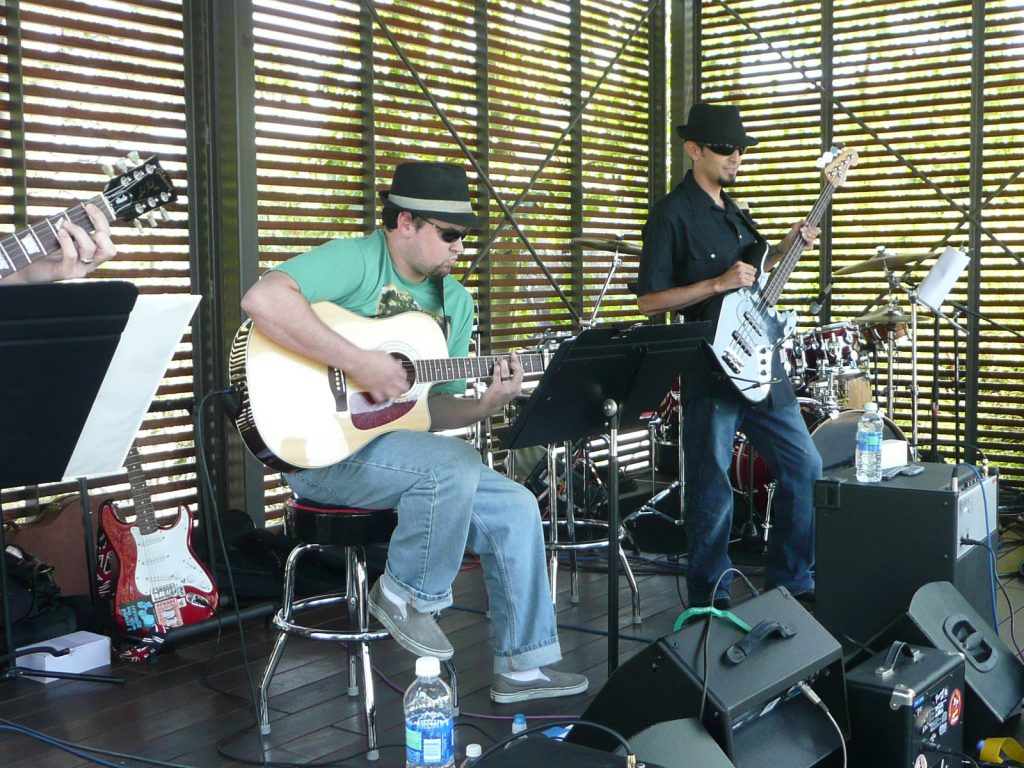 Imagineers playing as a band on the WDI campus.