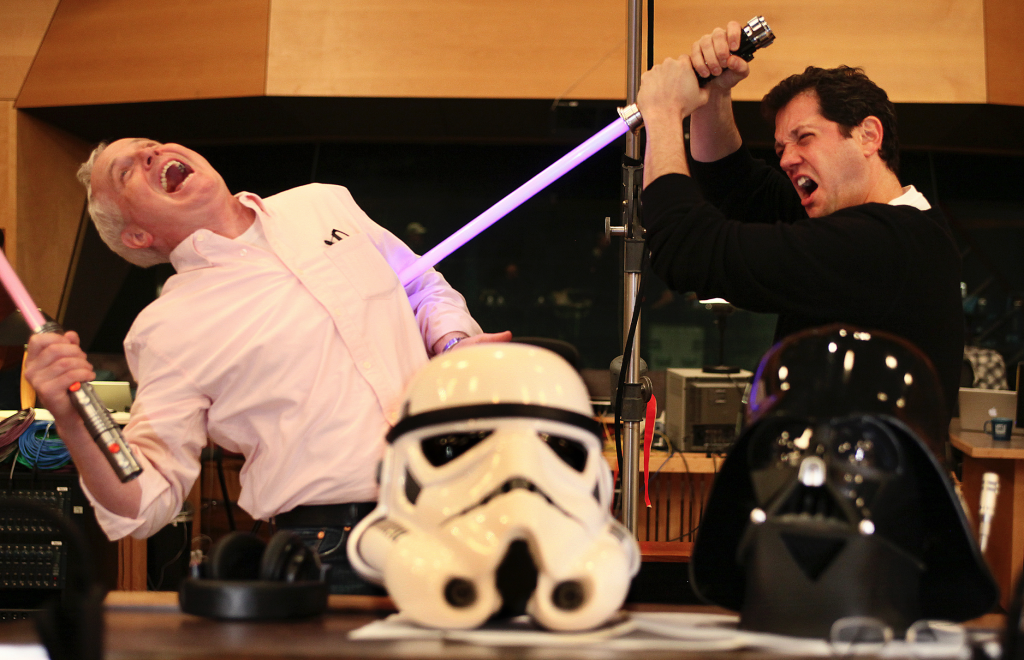 Imagineers using the force with their lightsabers.