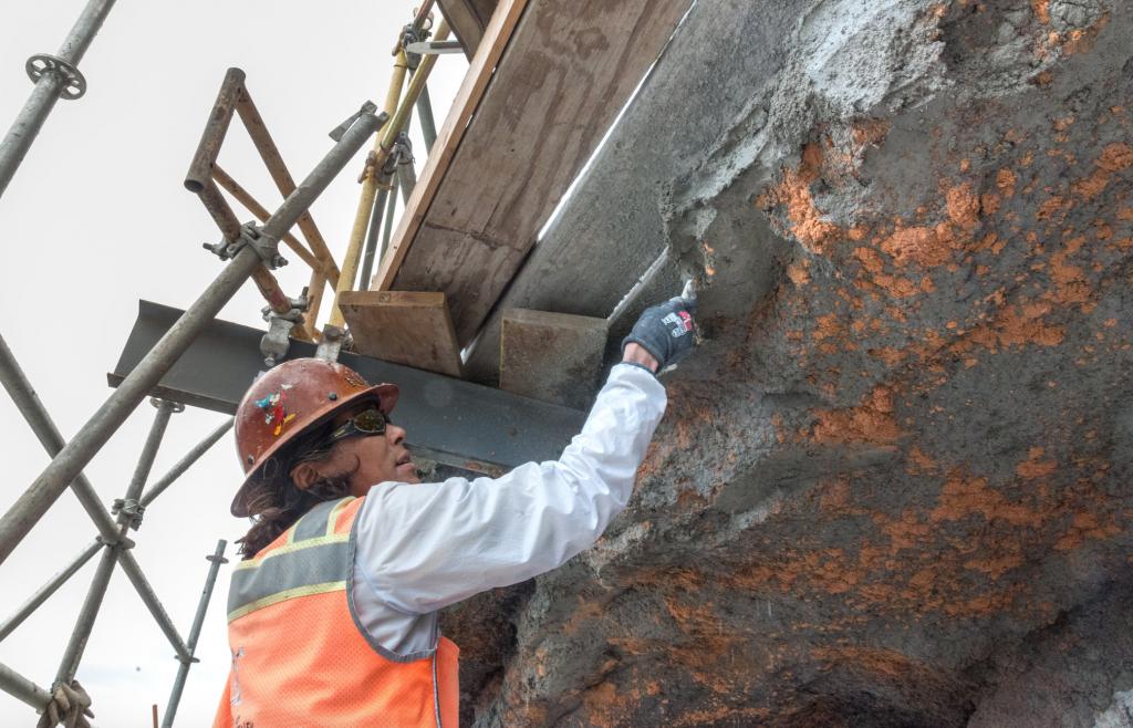 Imagineer working on rock work