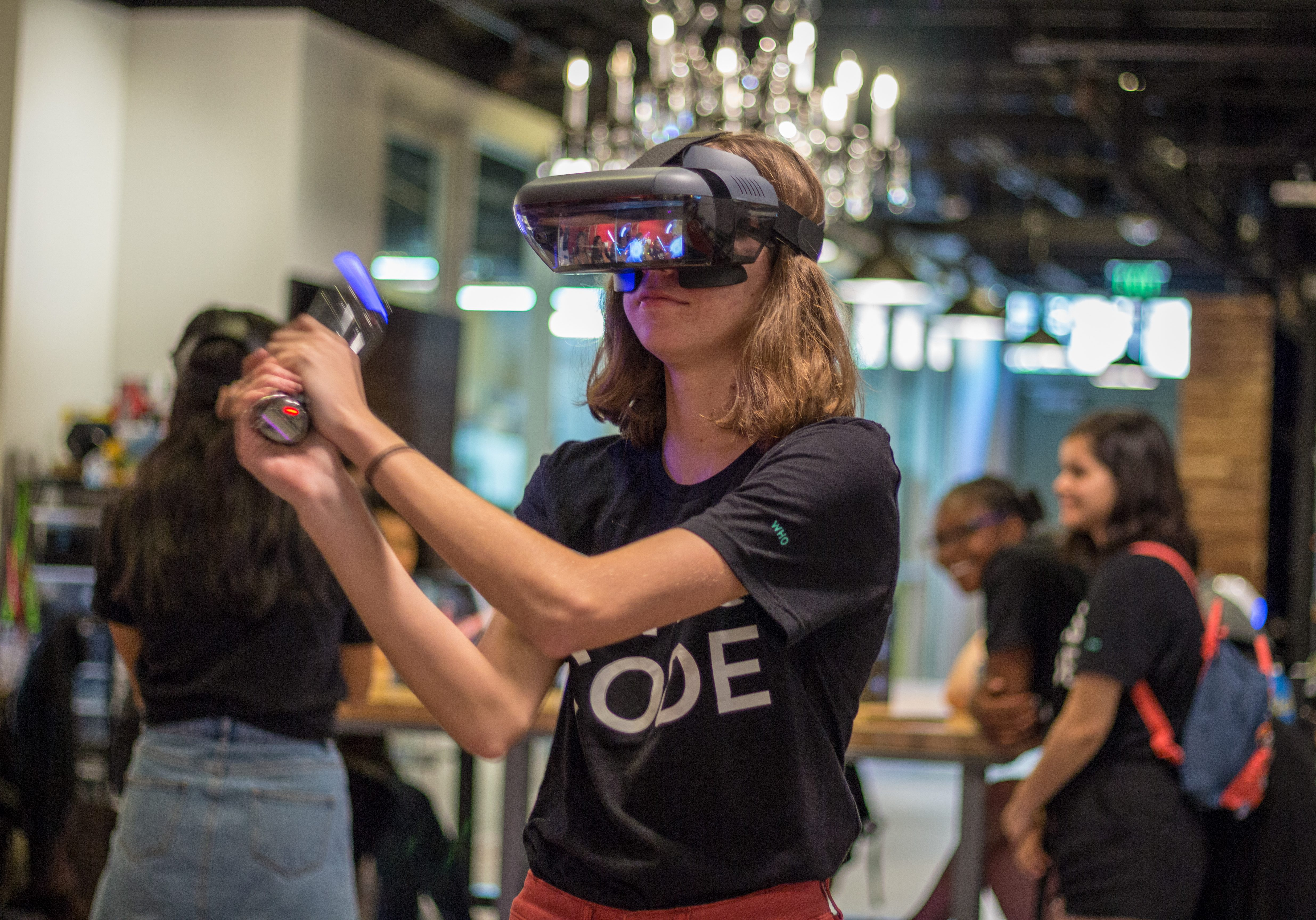 Girls Who Code participant working with VR.
