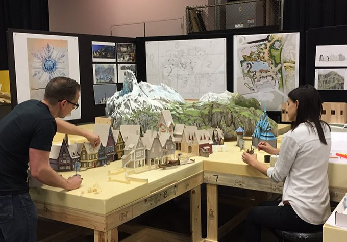 Imagineers working on a model.