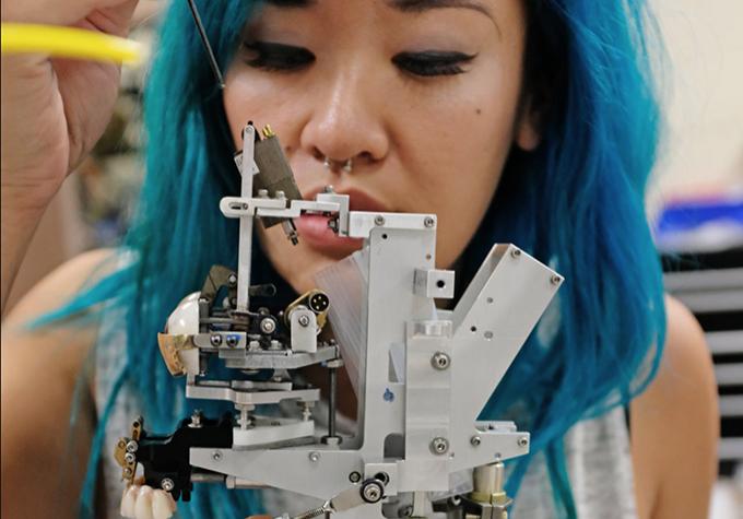 Imagineer working on a mechanical piece.