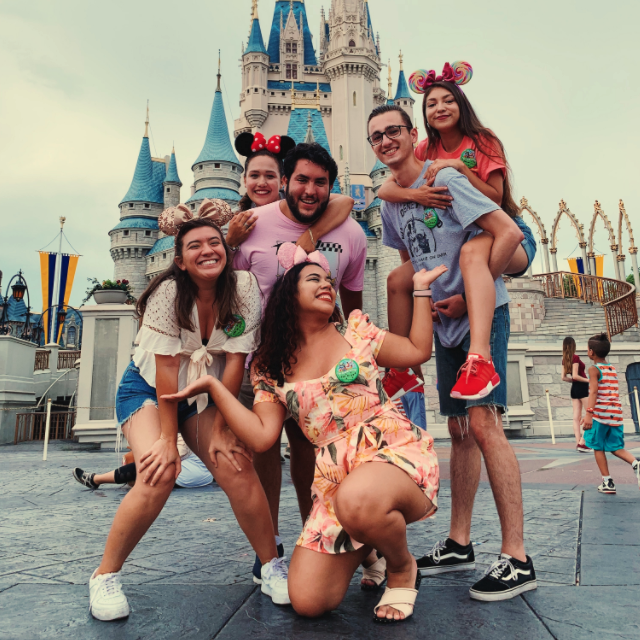 A group of participants takes a fun photo in front of Cinderella's Castle at Magic Kingdom Park