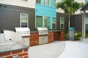 An outdoor grilling station at Flamingo Crossings Village